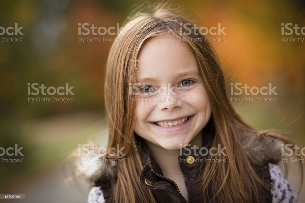 Close Up of Little Girl Standing Outside on Fall Day royalty-free stock photo