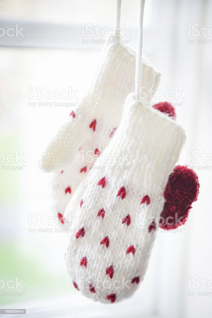 Close up of Love mittens hanging by the window royalty-free stock photo