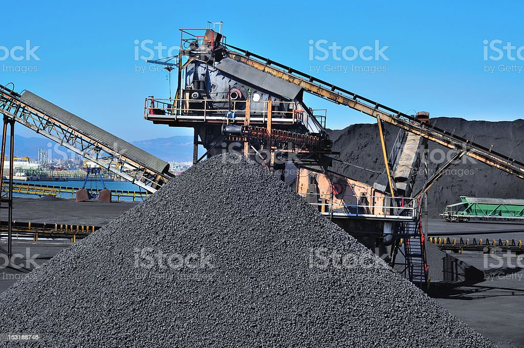 Close up of machines and a stockpile of coal stock photo