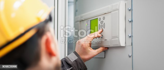 istock Close up of maintenance engineer testing voltage switchgear 909828996