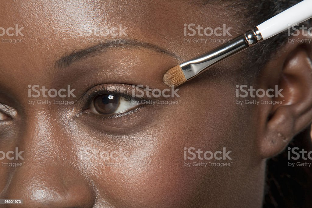 Close up of make up brush near eye royalty-free stock photo