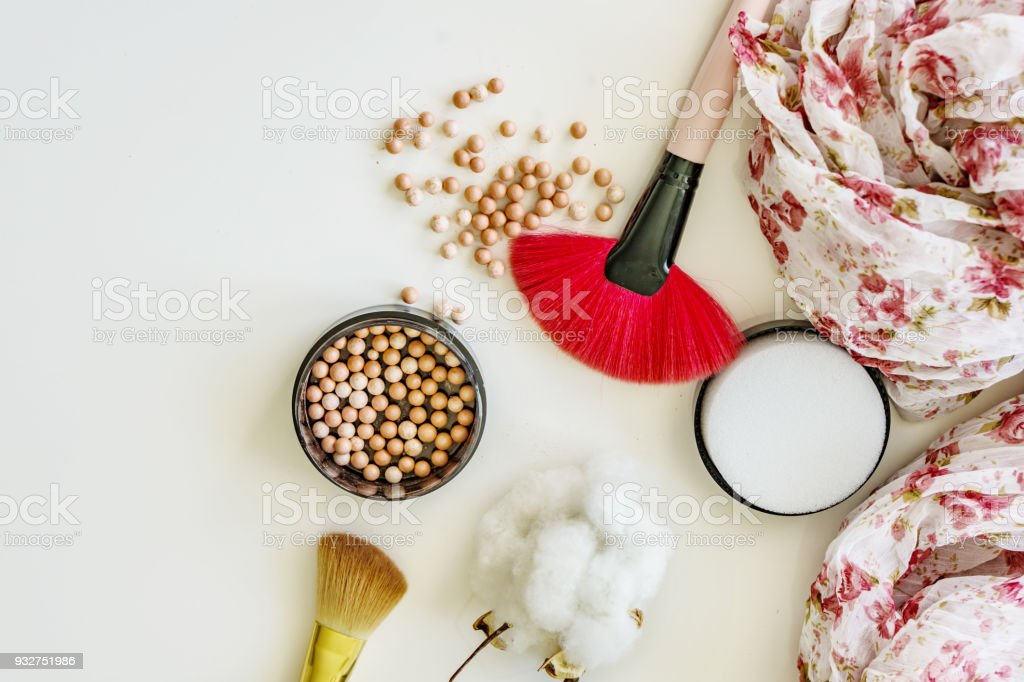 Close up of makeup, pearls, lipstick blush brush. Shallow depth of focus. Concept fashion and beauty. stock photo