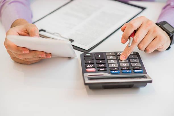 close up of male accountant or banker making calculations. - gerente de cuentas fotografías e imágenes de stock