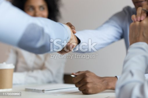 843963182 istock photo Close up of male colleagues handshake at business negotiations 1173335892