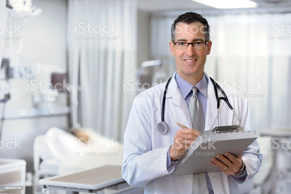 Close up of male doctor working stock photo