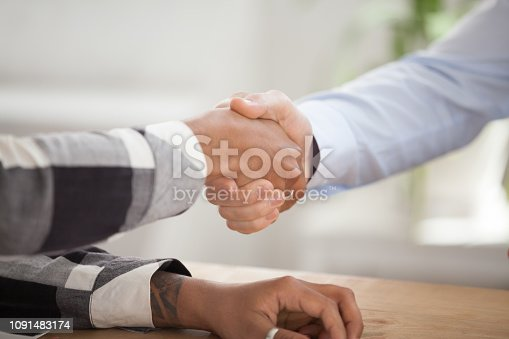 843963182 istock photo Close up of male employer handshake black candidate 1091483174