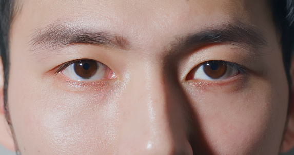 male eye close up from asian young man