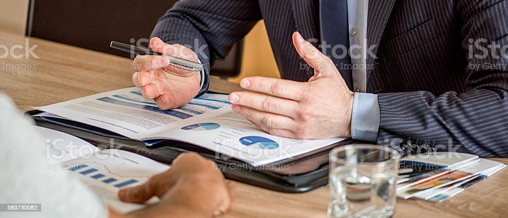 Close up of male hands on business document stock photo