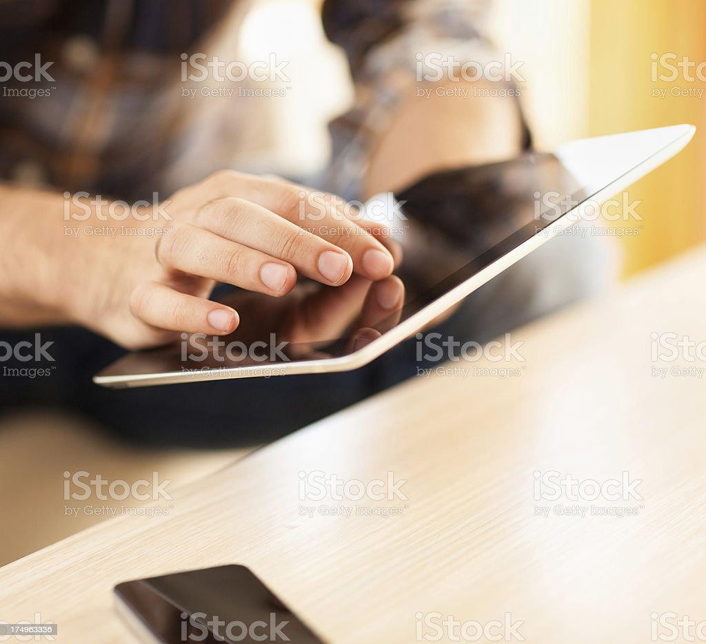 Close up of male hands using digital tablet royalty-free stock photo