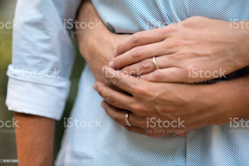 Close up of males hands with wedding ring. stock photo