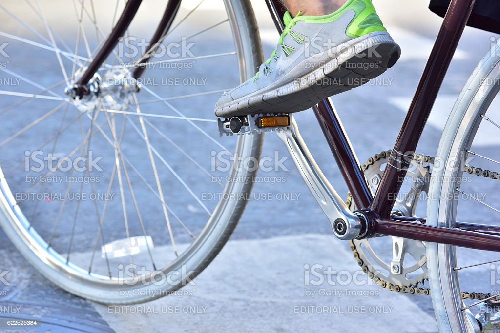 Close up of man and his bike, focus Nike shoe. stock photo