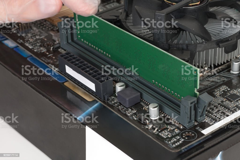 Close up of man hand  installing DDR4 memory stock photo