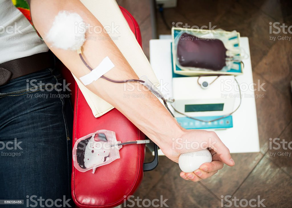 Close up of man hand on blood donation stock photo