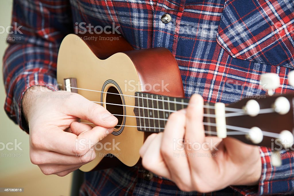 Close Up Of Man Playing Ukulele stock photo