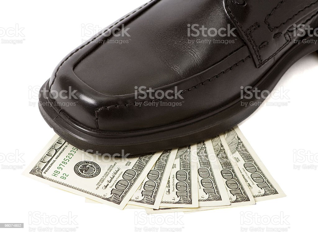Close up of man shoe on money stock photo