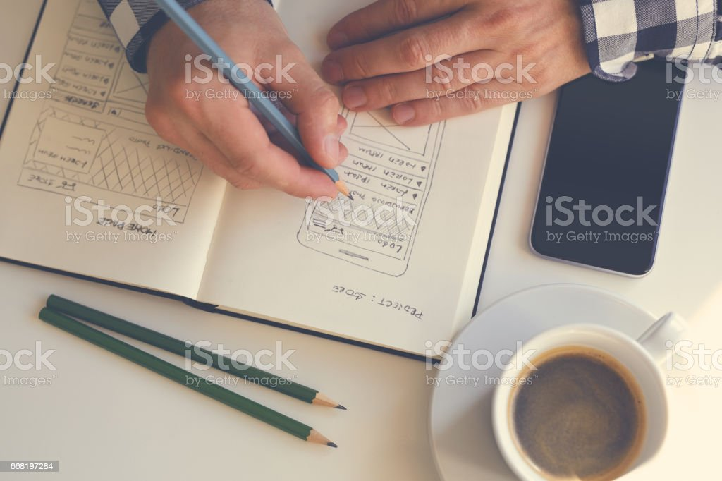 Close up of man sketching graphic sketch stock photo