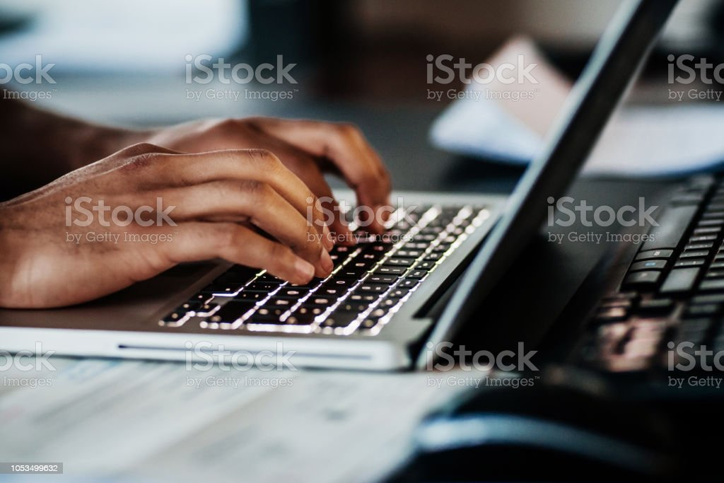 Close Up Of Man Typing On Laptop stock photo