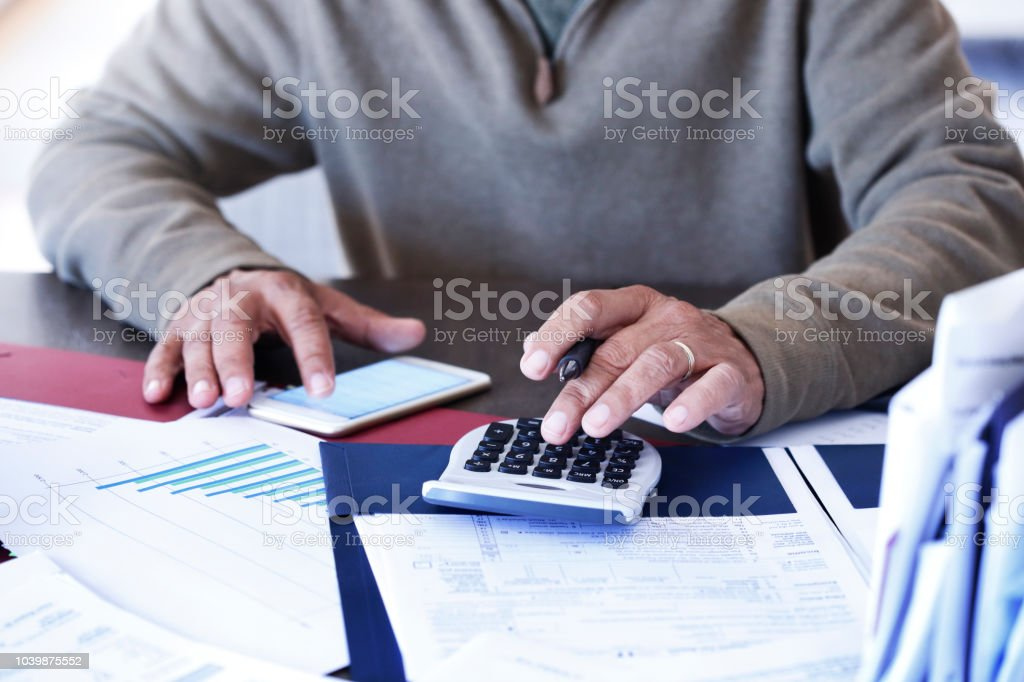 Close Up Of Man Using His Mobile Phone To Pay His Bills stock photo
