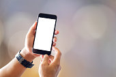 istock Close up of man with smartphones with blurred background. Communication and Technology Concept. 909037276
