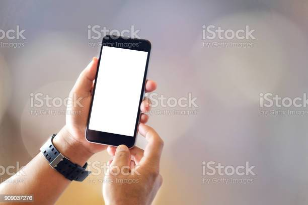 Close up of man with smartphones with blurred background and picture id909037276?b=1&k=6&m=909037276&s=612x612&h=0vcyfywaetnp28wjlqfpoex29zssrjaduxgqlc dbou=