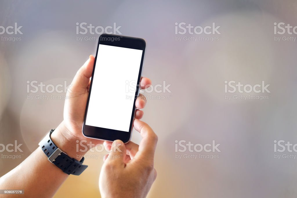 Close up of man with smartphones with blurred background. Communication and Technology Concept. stock photo