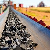 Close up of Manganese rock on a conveyor belt