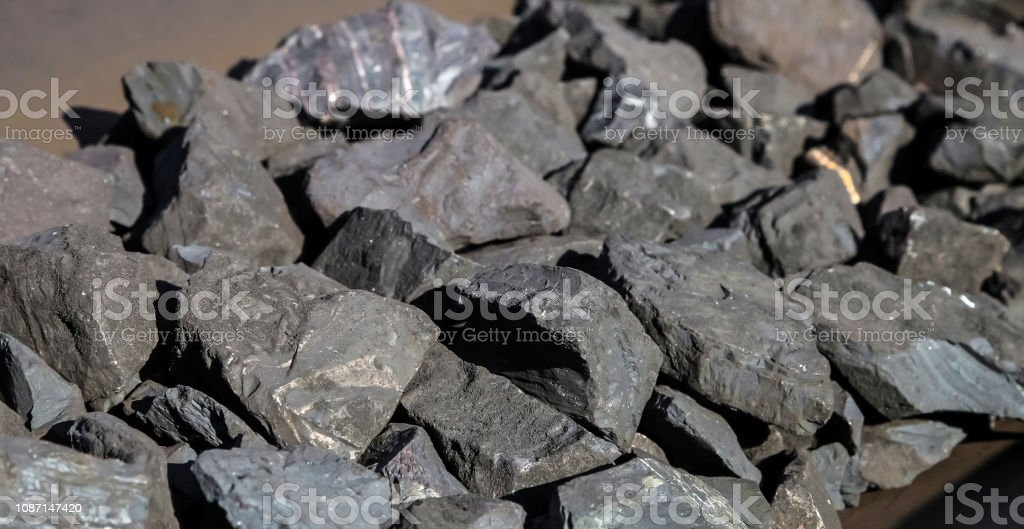 Close Up Of Manganese Rock On A Conveyor Belt Stock Photo - Download