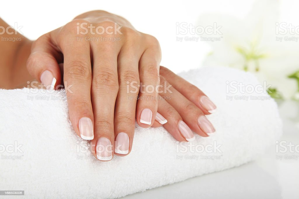 Close up of manicured hands resting on white towel stock photo