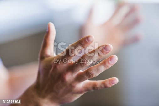 Close up of young man's hands.