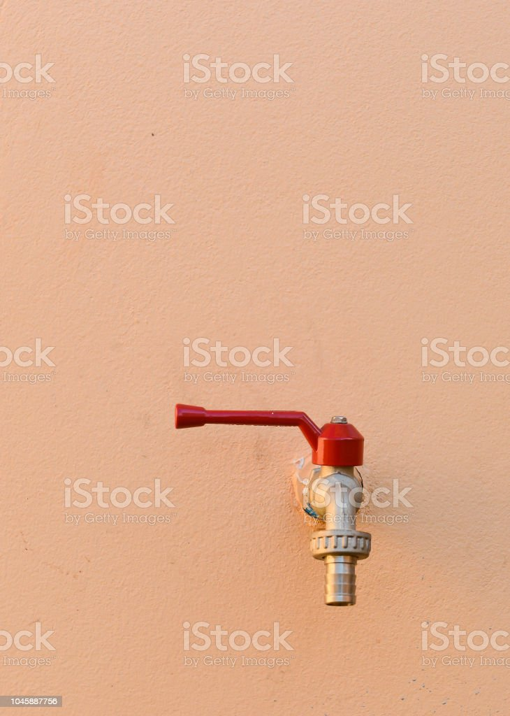 Close Up Of Manual Operate Red Metal Valve And Pipes Home Equipment