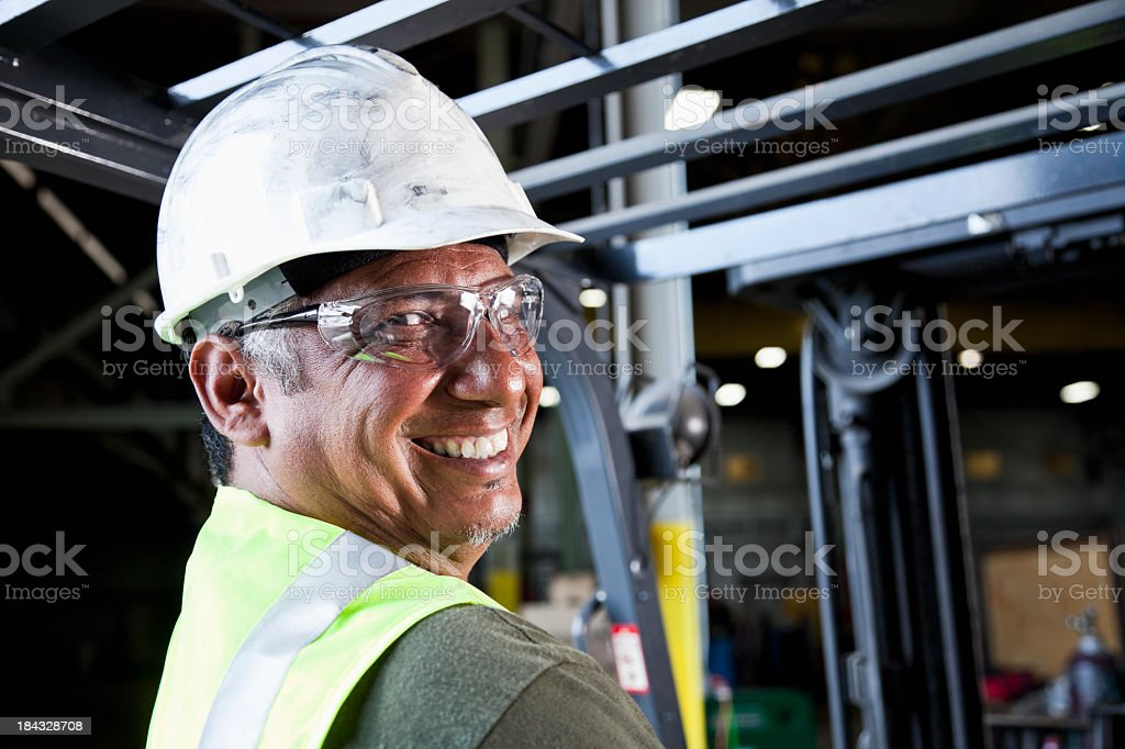 Close up of manual worker on forklift royalty-free stock photo