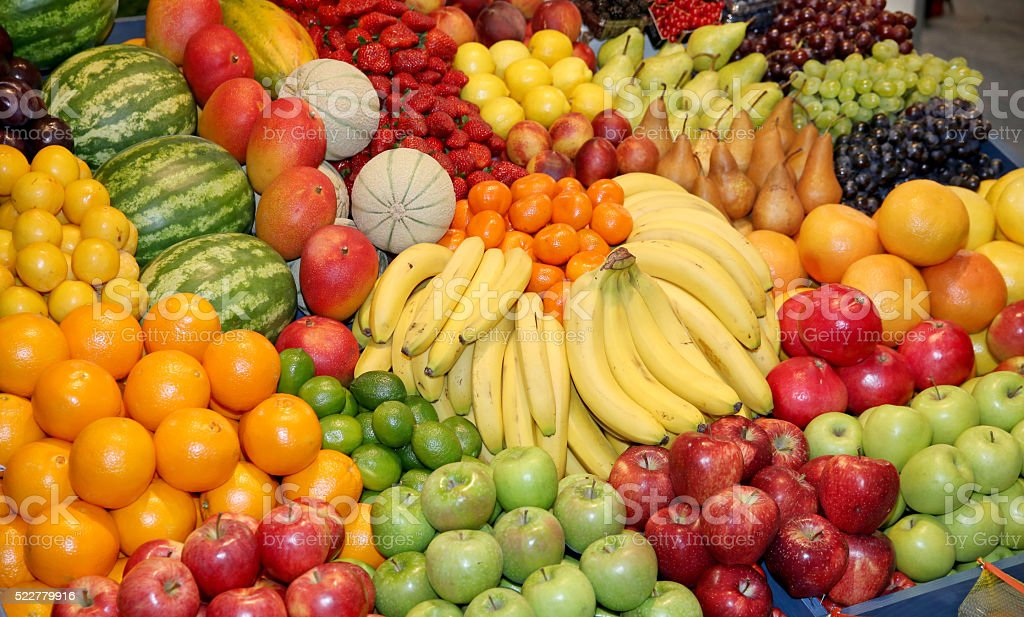 Close up of many colorful fruits on market stand stock photo