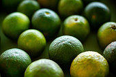 fresh limes with mint on white backgroundsee my
