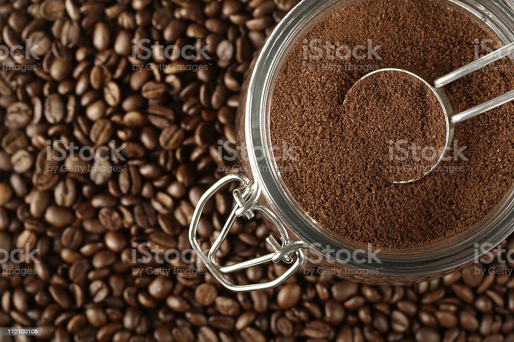 Close up of many whole coffee beans and ground coffee beans stock photo