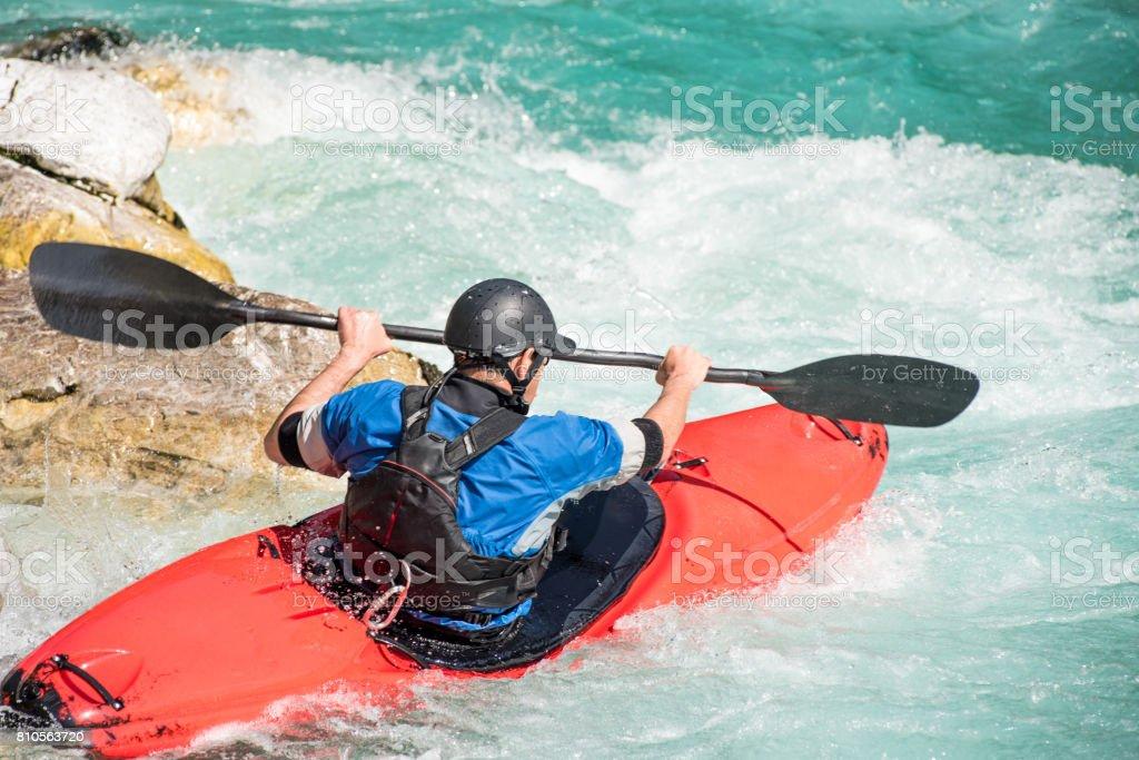 Close Up Of Mature Man Kayaking On White Water's stock photo
