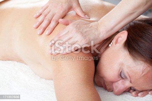 istock Close up of mature woman having massage 171352636