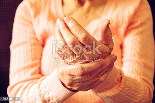 istock Close up of mature womans hands. Health care giving, nursing home. Parental love of grandmother. Old age related diseases. 918151152