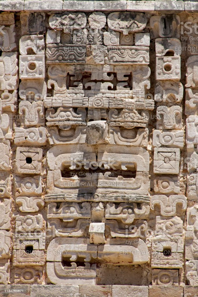 Close up of Mayan stone carvings depicting heads stock photo