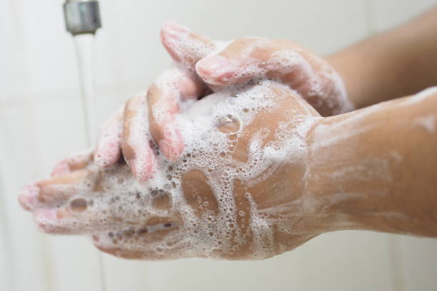 Close Up Of Medical Staff Washing Hands. Hand hygiene. Close Up Of Medical Staff Washing Hands. Hand hygiene. prokaryote stock pictures, royalty-free photos & images