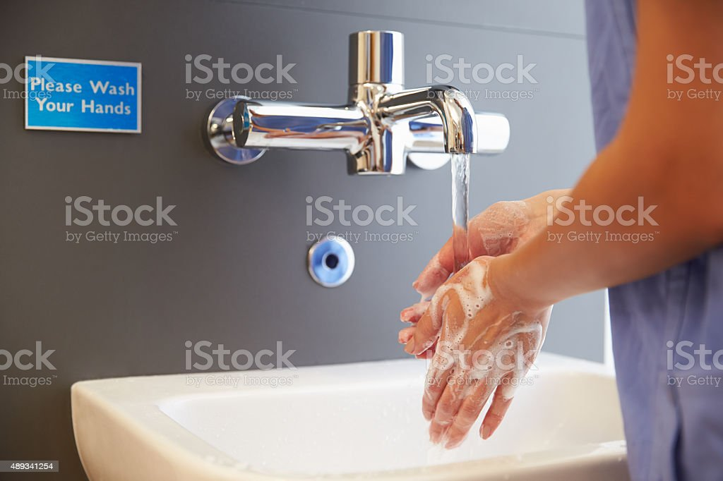 Close Up Of Medical Staff Washing Hands stock photo