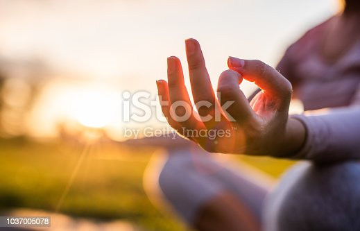 Close up of yoga outdoor at sunset.