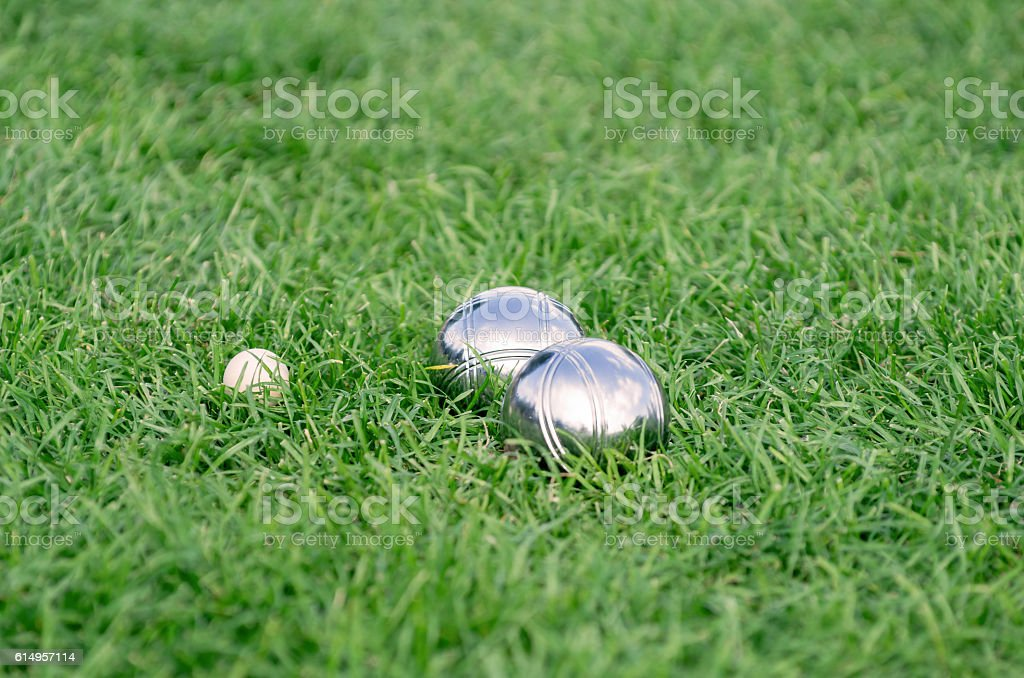 Close up of metal boule balls on the green lawn stock photo