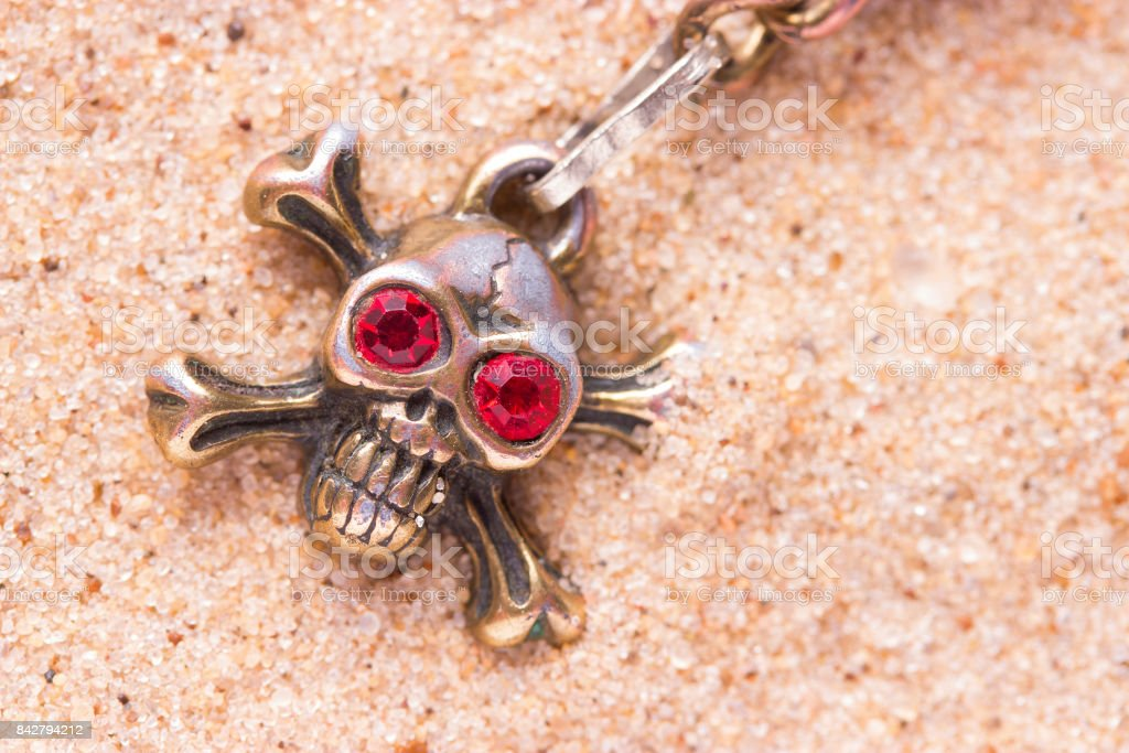 close up of metal skull with red eyes stock photo