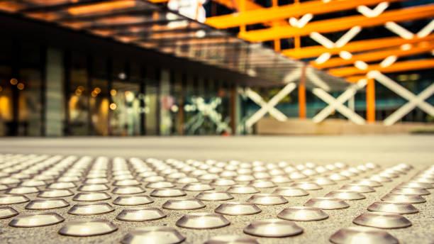 Close up of metal tactiles. Modern urban setting. stock photo