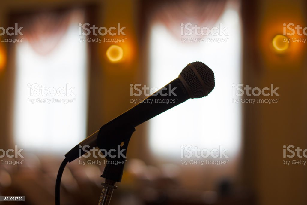 Close up of microphone in concert hall or conference room . royalty-free stock photo