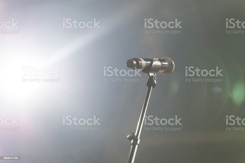 Close up of microphone in concert hall or conference room stock photo