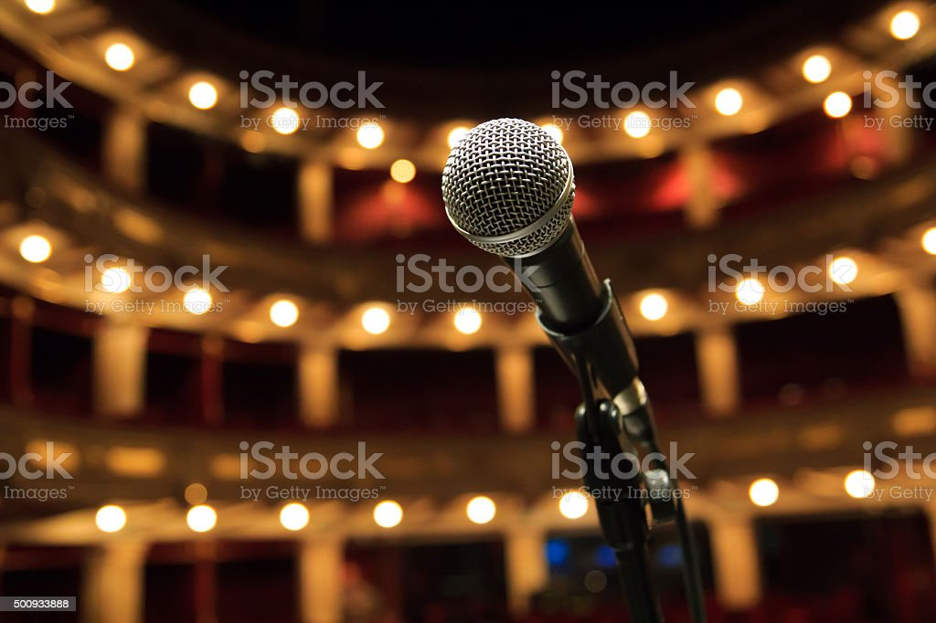 Close up of microphone in concert hall, theater stock photo