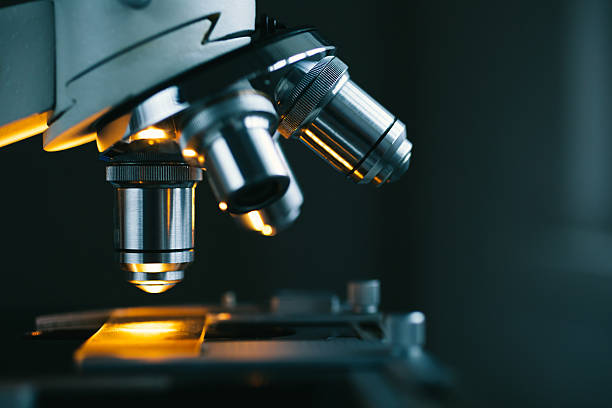 Close up of microscope and test sample stock photo