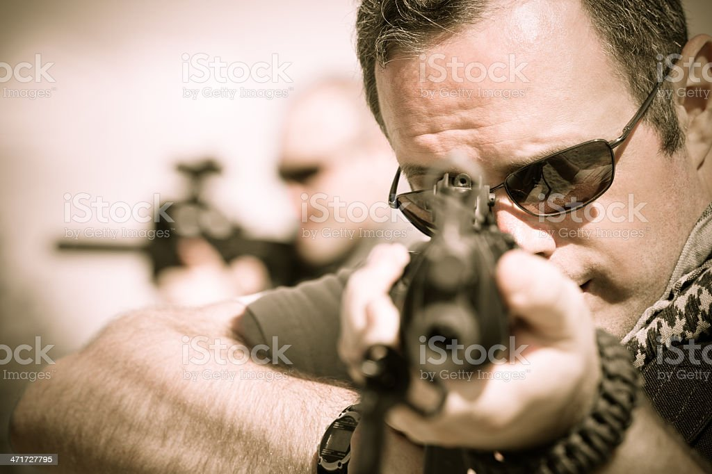 Close up of military soldier aiming weapon royalty-free stock photo