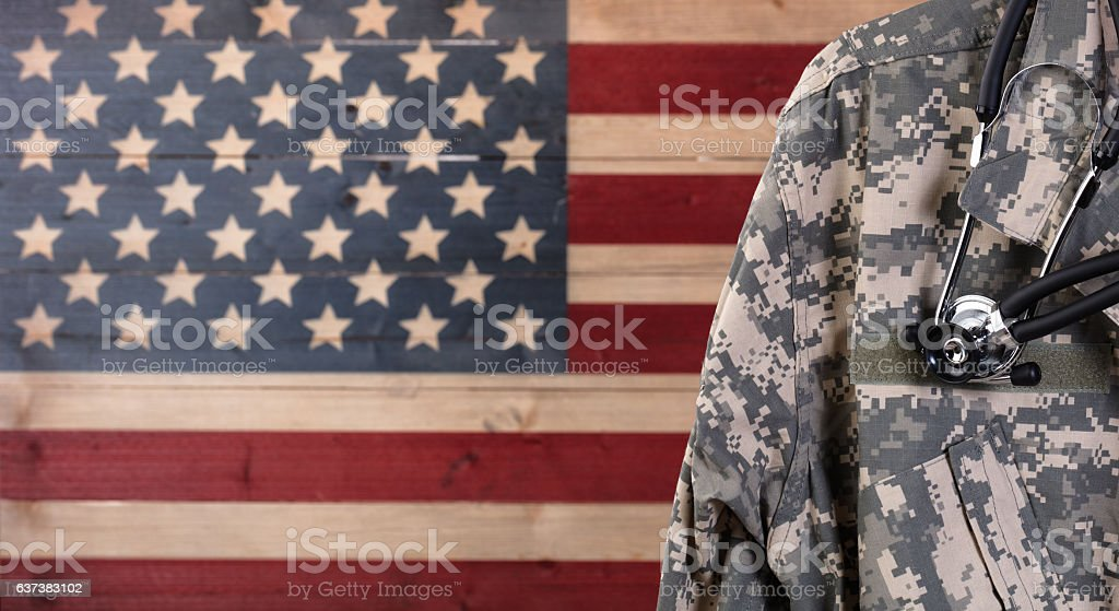 Close up of military uniform jacket and stethoscope with rustic stock photo